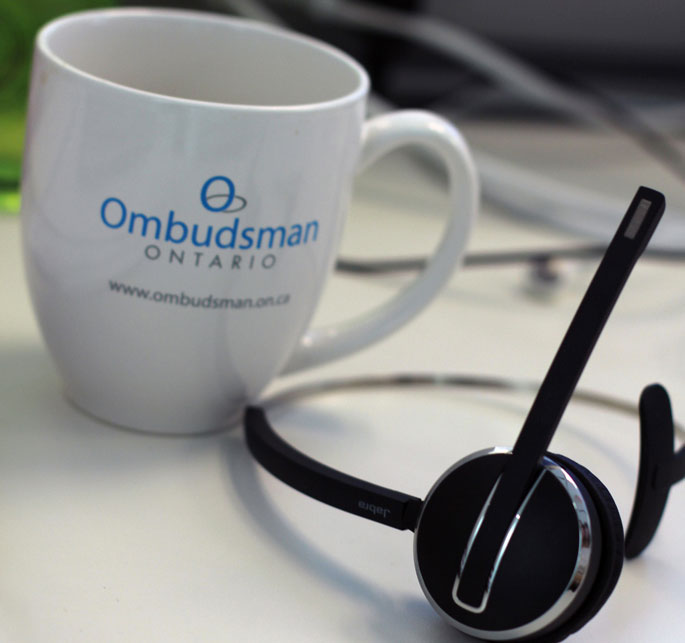 telephone headset and mug with the logo of the Ontario Ombudsman