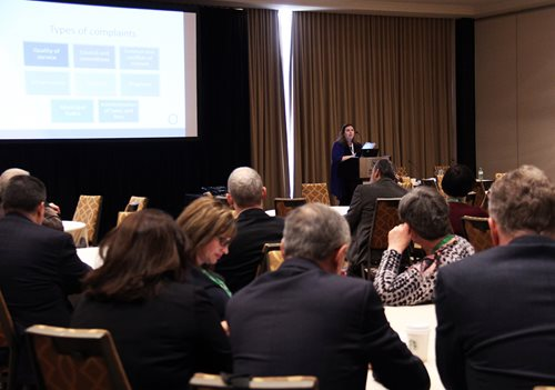 photo of General Counsel Laura Pettigrew presenting during ROMA conference.